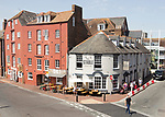 Old historic buildings on quayside at Poole harbour, Poole, Dorset, England, UK