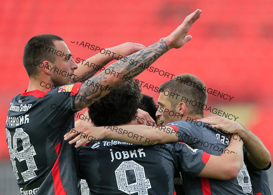Fudbal Jelen Super League season 2014-2015 <br /> Donji Srem v Crvena Zvezda<br /> Darko Lazovic (R) celebrate the goal with the Petar Orlandic (L) and Luka Jovic<br /> Novi Sad, 29.04.2015.<br /> foto: Srdjan Stevanovic/Starsportphoto&copy;