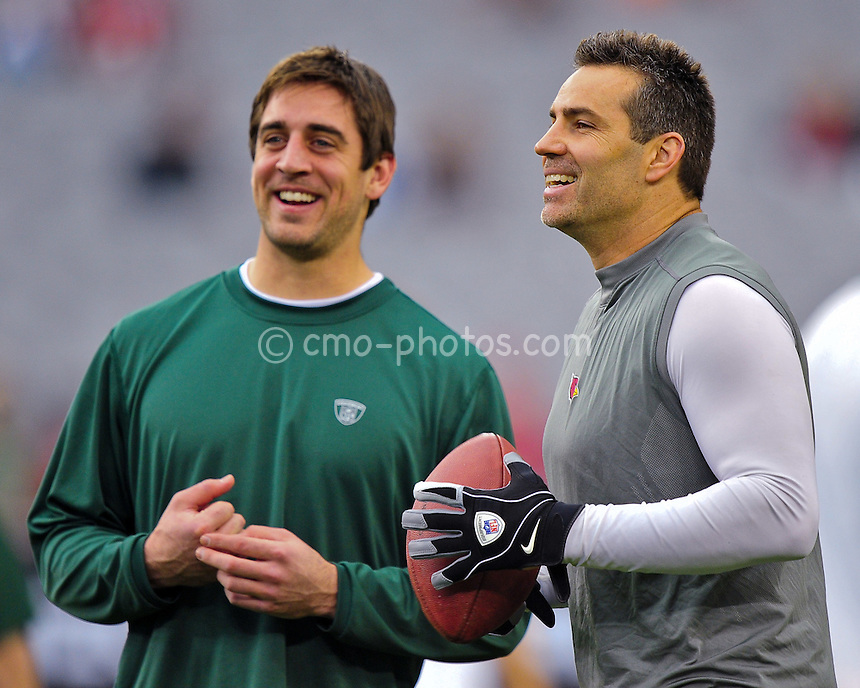 Jan 10, 2010; Glendale, AZ, USA; Green Bay Packers quarterback Aaron Rodgers (left) and Arizona Cardinals quarterback Kurt Warner (right) talk to each other prior to the 2010 NFC wild card playoff game at University of Phoenix Stadium.