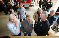 NWA Democrat-Gazette/DAVID GOTTSCHALK Peter Reagan (right) speaks with charter members of the Fayetteville Fire Fighters Association Local No. 2866, as they look over the original charter following a ceremonial bell ringing Wednesday, February 28, 2018, at Station 1 marking the 100th anniversary of the birth of the International Association of Fire Fighters. The Fayetteville Fire Department had 35 original members in their local charter that began on January, 25, 1982. The International Association of Fire Fighters was started in Washington D.C. in 1918.