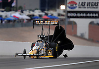Nov. 1, 2008; Las Vegas, NV, USA: NHRA top fuel dragster driver Tony Schumacher slows down following his championship clinching run during qualifying for the Las Vegas Nationals at The Strip in Las Vegas. Mandatory Credit: Mark J. Rebilas-
