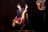 Buenos Aires, Argentina. A couple dancing the tango; she has her leg up over his shoulder.