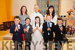 Pupils from Foilmore NS who made their First Holy Communion in the Church of Our Lady of the Immaculate Conception on Sunday pictured here front l-r; Donagh Sugrue, John Moriarty, Saoirse Garvey, Jack Griffin, Denis Ryan Hill, back l-r; Nora Golden, Canon Larry Kelly & Caragh O'Sullivan.