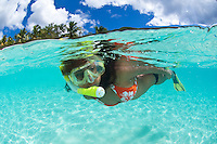 Split level view of snorkeler<br /> .Honeymoon Beach<br /> .Virgin islands National Park. St John