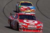 Oct. 11, 2009. Auto Club Speedway, CA: Juan Pablo Montoya races out in front of Kyle Busch through turn 3.