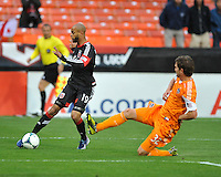 Kyle Porter (19) of D.C. United goes against Bobby Boswell(32) of the Houston Dynamo. The Houston Dynamo defeated D.C. United 4-0, at RFK Stadium, Wednesday May 8 , 2013.
