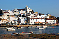 Portugal, Algarve, near Portimao: View across river Arade to the traditional white fishing village Ferragudo