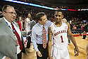 December 4, 2013: Head coach Tim Miles of the Nebraska Cornhuskers puts his arm around Deverell Biggs (1) after the game against the Miami (Fl) Hurricanes at the Pinnacle Bank Areana, Lincoln, NE. Nebraska defeated Miami 60 to 49.