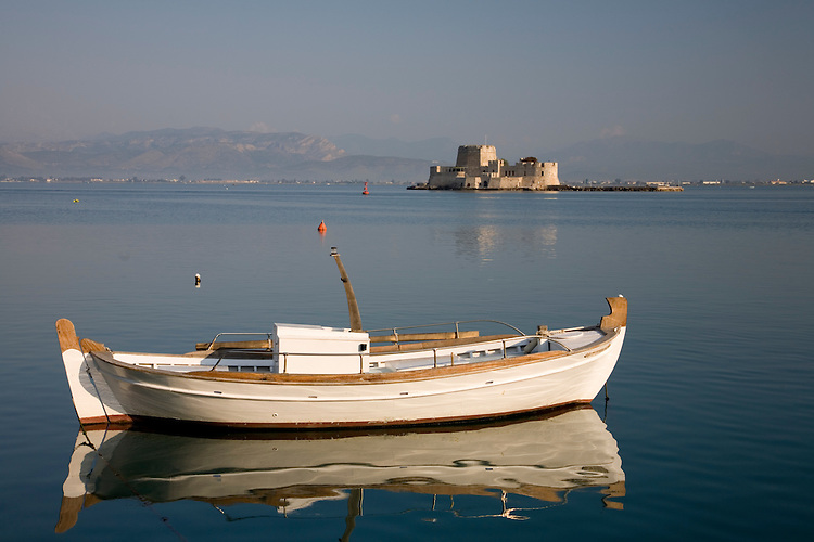 Nafplio on the Argolic Gulf.  The mightly little fortress island just offshore, called Bourtzi, was built during the first Venetian occupation (15th century) to protect the harbor.