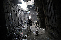 Monday 13 July, 2015: A metal worker is seen in the iron market streets of the Old City of Sana'a, a 2,500-year-old cultural heritage site endangered after a fighter jet of the Saudi-led coalition bombed and destroyed a line of residential tower-houses killing 4 residents and reducing to rubble the historial site. The ongoing aerial campaign of bombardments by the Arab states and their western allies led by Saudi Arabia and the heavy fighting against the entrenchment of the Houthi insurgency along the Yemeni main cities from north to south has caused an international alert for the enlisted cultural heritage sites in Yemen, such as the historic town of Zabid, the Old City of Sana'a and the Old Walled City of Shibam. (Photo/Narciso Contreras)