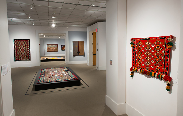 Kennedy Museum of Art marks 20 years by recounting the story of exhibiting Navajo weavings from its unparalleled Southwest Native American Collection. Highlights of the collection donated to Ohio University by Edwin L. and Ruth E. Kennedy are shown alongside 21st century acquisitions. Over 40 weavings are on display, featuring a First Phase Ute Wearing Blanket, regional styles such as Teec Nos Pos and Two Grey Hills, and significant pictorials, including the last known sandpainting weaving by Navajo hataalii Hosteen Klah.
