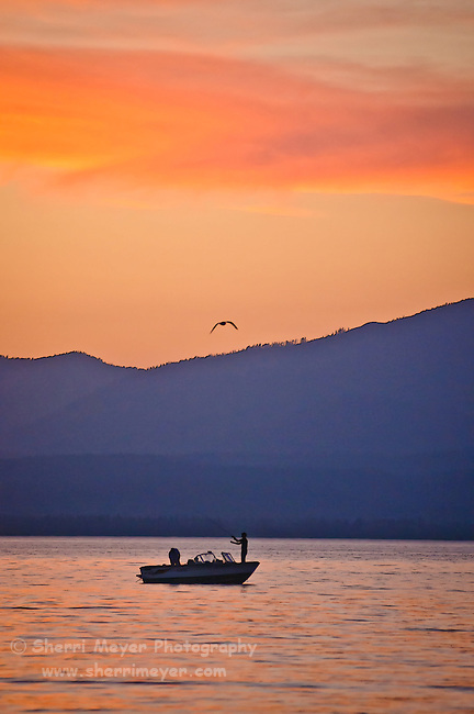 Men fishing from a boat on Lake Almanor, Northern California.