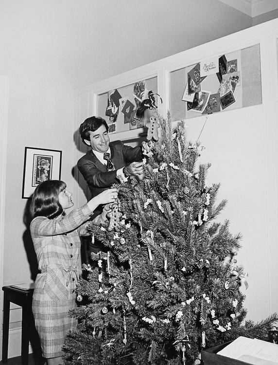 Congressman and his staff member decorating Christmas tree at his office around Christmas. (Photo by Dev O'Neill/CQ Roll Call via Getty Images)