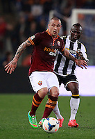 Calcio, Serie A: Roma vs Udinese. Roma, stadio Olimpico, 17 marzo 2014.<br /> AS Roma midfielder Radja Nainggolan, of Belgium, left, is challenged by Udinese midfielder Emmanuel Badu, of Ghana, right, after scoring after scoring during the Italian Serie A football match between AS Roma and Udinese at Rome's Olympic stadium, 17 March 2014.<br /> UPDATE IMAGES PRESS/Isabella Bonotto