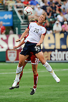 Abby Wambach (20) of the United States (USA) heads the ball. The United States (USA) Women's National Team defeated Canada (CAN) 1-0 during an international friendly at Marina Auto Stadium in Rochester, NY, on July 19, 2009.