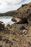 Chile, Easter Island: The cave Ana Kai Tangata was where commoners waited to hear the birdman ritual outcome that determined who would be king of the year.  On the top of the cave they painted birdman symbols..Photo #: ch306-33671.Photo copyright Lee Foster www.fostertravel.com lee@fostertravel.com 510-549-2202