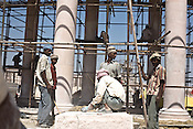 Migrant labourers from Rajasthan and other states are seen working on Dr. Bhimrao Ambedkar Smarak Parivartan Sthal built by Uttar Pradesh chief minister, Mayawati in Lucknow, India. Mayawati is channeling huge state funds into making structures and sand stone monstrosities using public funds in the state capital, Lucknow.