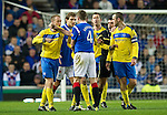 Rangers v St Johnstone...19.11.11   Scottish Premier League.Steven Anderson and Kirk Broadfoot square up as ref Euan Norris tries to intervene.Picture by Graeme Hart..Copyright Perthshire Picture Agency.Tel: 01738 623350  Mobile: 07990 594431