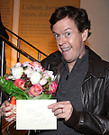 Dylan Baker with flowers for his wife attending the Opening Night for the Playwrights Horizons World Premiere Production of 'The Great God Pan' at Playwrights Horizons Theatre in New York City on December 18, 2012