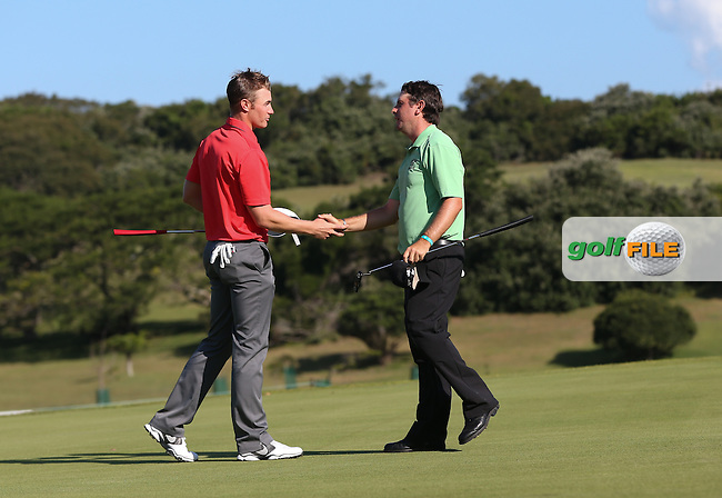 Oliver Fisher (ENG) congratulates Thomas Aiken (RSA) who is the Champion Golfer winning Final Round play-off at The Africa Open 2014 at the East London Golf Club, Eastern Cape, South Africa. Picture:  David Lloyd / www.golffile.ie