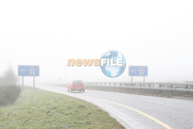 Fog causes bad driving conditions today on the M1...Photo NEWSFILE/Jenny Matthews.(Photo credit should read Jenny Matthews/NEWSFILE)....This Picture has been sent you under the condtions enclosed by:.Newsfile Ltd..The Studio,.Millmount Abbey,.Drogheda,.Co Meath..Ireland..Tel: +353(0)41-9871240.Fax: +353(0)41-9871260.GSM: +353(0)86-2500958.email: pictures@newsfile.ie.www.newsfile.ie.FTP: 193.120.102.198.