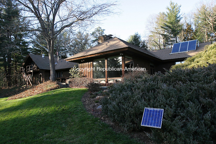 CANTON, CT - 29 November 2004- 112904BZ03- The Canton home of Judi Friedman has several solar panels on the property.  The panels on the roof are for hot water while the small panel in the foreground powers a circulating pump for a bird bath.<br /> The Friedman's said they get about 75% of their electricity for the year from solar power.<br /> (       are CQ)<br /> Jamison C. Bazinet Photo