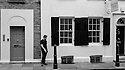 London, UK. 04.04.2015. Man having a cigarette, East London. Photograph © Jane Hobson.