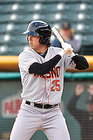 Tyler Colvin (25) of the Fresno Grizzlies  at bat against the Salt Lake Bees at Smith's Ballpark on April 9, 2014 in Salt Lake City, Utah.  (Stephen Smith/Four Seam Images)