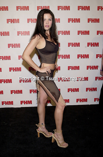 Christa Campbell arriving at The magazine FHM salutes the 100 sexist women of the world at La Boheme cafe in Los Angeles 5/17/2001 CampbellChrista09.JPG