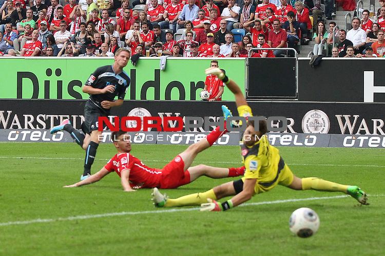 09.08.2013, Espirt Arena, Duesseldorf, GER, 2. FBL, Fortuna D&uuml;sseldorf vs TSV 1860 Muenchen, im Bild<br /> Marin Tomasov (Muenchen #14) trifft zum 1:2 gegen Fabian Giefer (Torwart Duesseldorf) (re.) und Dustin Bomheuer (Duesseldorf #6)<br /> <br /> Foto &copy; nph / Mueller       *** Local Caption ***