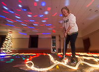 NWA Democrat-Gazette/BEN GOFF @NWABENGOFF<br /> Clara Orvin, 15, of Fayetteville putts on one of the holes Friday, Nov. 30, 2018, during teen mini golf night at the Fayetteville Public Library. Staff from each department at the library designed and built each hole with a unique theme. Staff counted fifty children and teens in attendance at the event.
