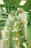 Lab technicians working with large vats of liquid in bioengineering laboratory, California. Career. Occupation. Technology. California.
