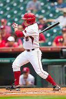 Jimmy Bosco #6 of the Arkansas Razorbacks follows through on his swing against the Texas Tech Red Raiders at Minute Maid Park on March 2, 2012 in Houston, Texas.  The Razorbacks defeated the Red Raiders 3-1. (Brian Westerholt/Four Seam Images)