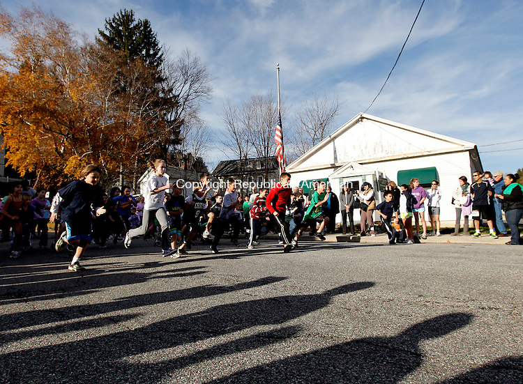 Thomaston, CT- 14, November 2010-111410CM05 Children of all ages, take off at the start of the Kids Fun Run Sunday afternoon during the Diane Burr Memorial Flag Fun 5k in Thomaston.   The event established 8 years ago, honors Diane Burr who lost her battle with cancer.  Monies raised for the race go to a variety of charities including the Hope Clinic and Harold Leever Center.  Brandon Atuins of Old Lyme was the overall finisher in a time of 16:52.   Christopher Massa Republican-American