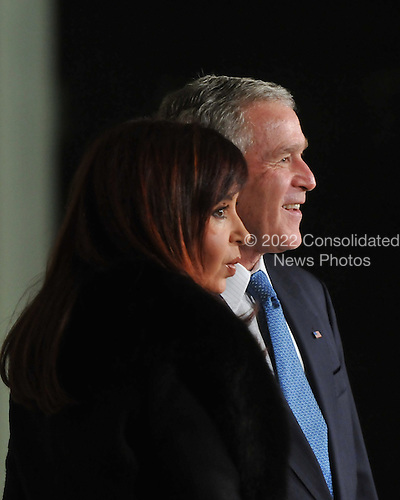 Washington, D.C. - November 14, 2008 -- United States President George W. Bush welcomes President Cristina Fernandez de Kirchner of Argentina to the Summit on Financial Markets and the World Economy on the North Portico of the White House in Washington, D.C. on Friday, November 14, 2008..Credit: Ron Sachs / Pool via CNP