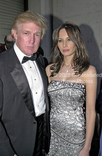 Donald Trump and Melania Knauss visit the Bloomberg hospitality suite prior to the White House Correspondents Association Dinner at the Washington Hilton Hotel in Washington, DC on April 28, 2001.<br /> Credit: Ron Sachs / CNP