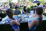 Devon Kopp and Alyssa Birri, both 9, check out the book selection at the Summer Reading Program Pancake Breakfast Kick-Off at the Carson City Library, in Carson City, Nev., on Saturday, June 8, 2013. <br /> Photo by Cathleen Allison