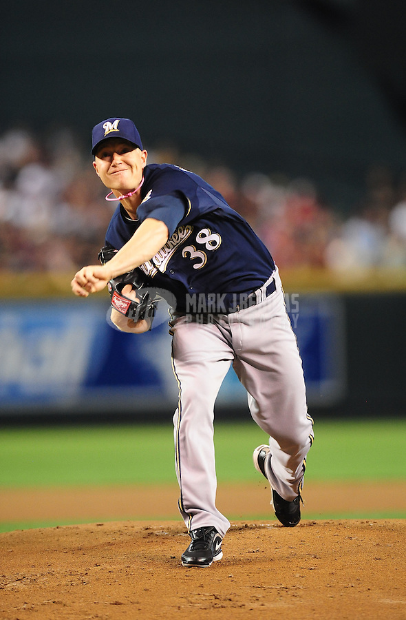 May 9, 2010; Phoenix, AZ, USA; Milwaukee Brewers pitcher Chris Narveson against the Arizona Diamondbacks at Chase Field. Players are wearing pink arm bands and using pink bats in honor of breast cancer awareness and Mothers Day. The Brewers defeated the Diamondbacks 6-1. Mandatory Credit: Mark J. Rebilas-