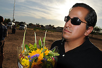 """Gilbert, Arizona – Friends and family of the Mederos Family gathered to hold a memorial for the four victims of the Gilbert Massacre occurred on May 2, 2012. According to Gilbert Police, Lisa Mederos, Amber Mederos, baby Lilly Mederos, and Jim Hiott (Amber's fiancé) were all killed by notorious white supremacist and Neo-Nazi Jason """"J.T."""" Ready before taking his own life. In this image, a high-school friend of victim Amber Mederos attends the memorial for Amber, her mom, her baby and her fiancee. Amber's friend did not want to provide his name. Photo by Eduardo Barraza © 2012"""