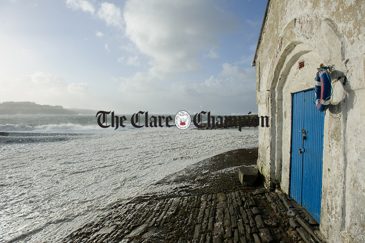The waves pound and foam blows like snow in Kilkee during Storm Imogen. Photograph by John Kelly.