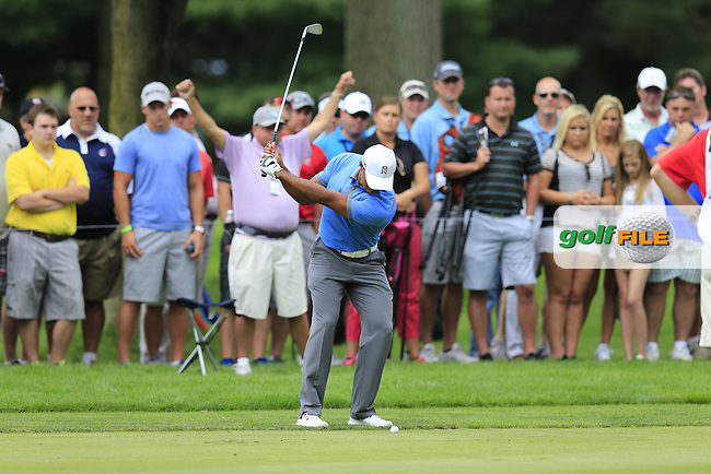 Tiger Woods (USA) plays his 2nd shot on the 10th hole during Friday's Round 1 of the 2013 Bridgestone Invitational WGC tournament held at the Firestone Country Club, Akron, Ohio. 2nd August 2013.<br /> Picture: Eoin Clarke www.golffile.ie