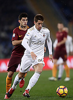 Calcio, Serie A: Roma vs Milan. Roma, stadio Olimpico, 12 dicembre 2016.<br /> Milan's Mario Pasalic, right, is chased by Roma&rsquo;s Diego Perotti during the Italian Serie A football match between Roma and AC Milan at Rome's Olympic stadium, 12 December 2016.<br /> UPDATE IMAGES PRESS/Isabella Bonotto