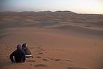 Watching sunrise, Camel trekking through the sand dunes of Merzouga, Morocco