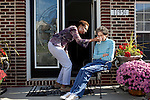 "Karen Morris has been caring for her mother Gloria, 80, for the past 10 years. Her mother has Alzheimer's disease and lives with Karen and Karen's husband Richard in their Charlotte, NC home. The pair take in the morning sunshine on the front porch. ..Mrs. Morris was a nurse before she retired and really enjoys taking care of people, she said. Every morning she washes her mother in the bathroom, helps her walk down the stairs, and they share breakfast, as they did Monday, October 18, 2010...Gloria was having an especially bad day and because Karen sees her every day, she knew something was wrong. She later discovered her medication was dehydrating her. That is one of many reasons why having a regular caretaker is so important. ..Released: Yes.""Caretaker"".Assignment c/o Ilene Bellovin"