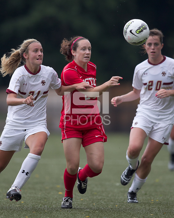 Boston College forward/midfielder Kate McCarthy (21) and Boston University midfielder Megan McGoldrick (21) chase down long pass. After 2 complete overtime periods, Boston College tied Boston University, 1-1, after 2 overtime periods at Newton Soccer Field, August 19, 2011.