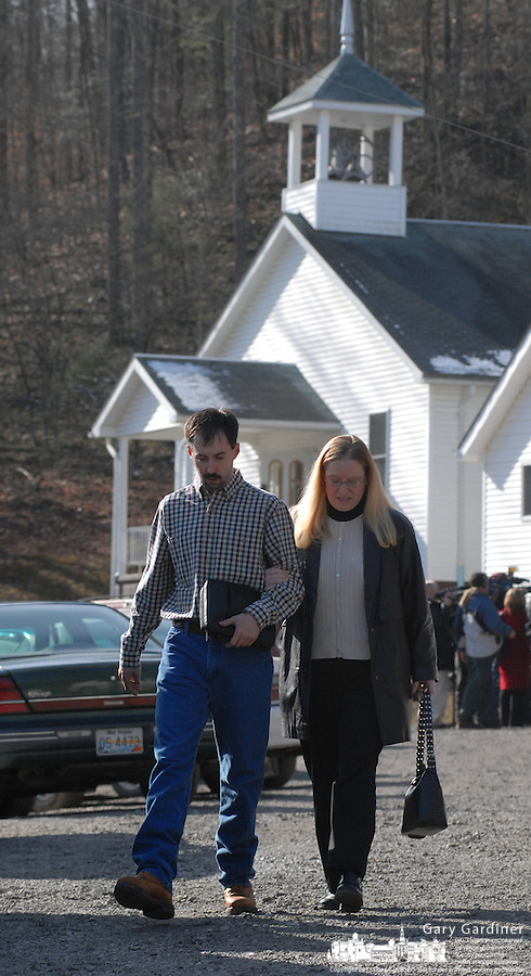 A couple leaves the Sago Baptist Church after services Sunday, Jan. 8, 2006,  near the mine where 12 miners were killed in an explosion last Monday near Buckhannon, WV. WV.(Photo by Gary Gardiner)<br />