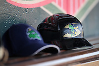 Beloit Snappers hat and coaches helmet in the dugout before a game against the Great Lakes Loons at Dow Stadium on July 22, 2011 in Midland, Michigan.  Great Lakes defeated Beloit 5-2.  (Mike Janes/Four Seam Images)
