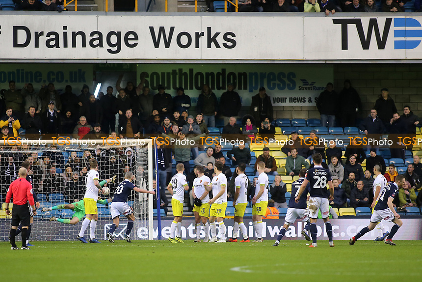 Shane Ferguson (far right) scores Millwall's second goal and celebrates during Millwall vs Hull City, Emirates FA Cup Football at The Den on 6th January 2019