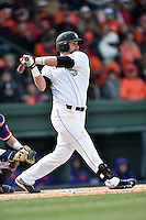 South Carolina first baseman Kyle Martin (33) swings at a pitch during a game against the Clemson Tigers at Fluor Field February 28, 2015 in Greenville, South Carolina. The Gamecocks defeated the Tigers 4-1. (Tony Farlow/Four Seam Images)