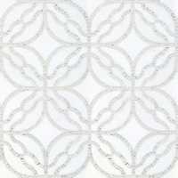 Claudette, a hand-cut and waterjet stone mosaic, shown in polished Afyon White and tumbled Thassos, is part of the Parterre Collection by Sara Baldwin for New Ravenna.<br />